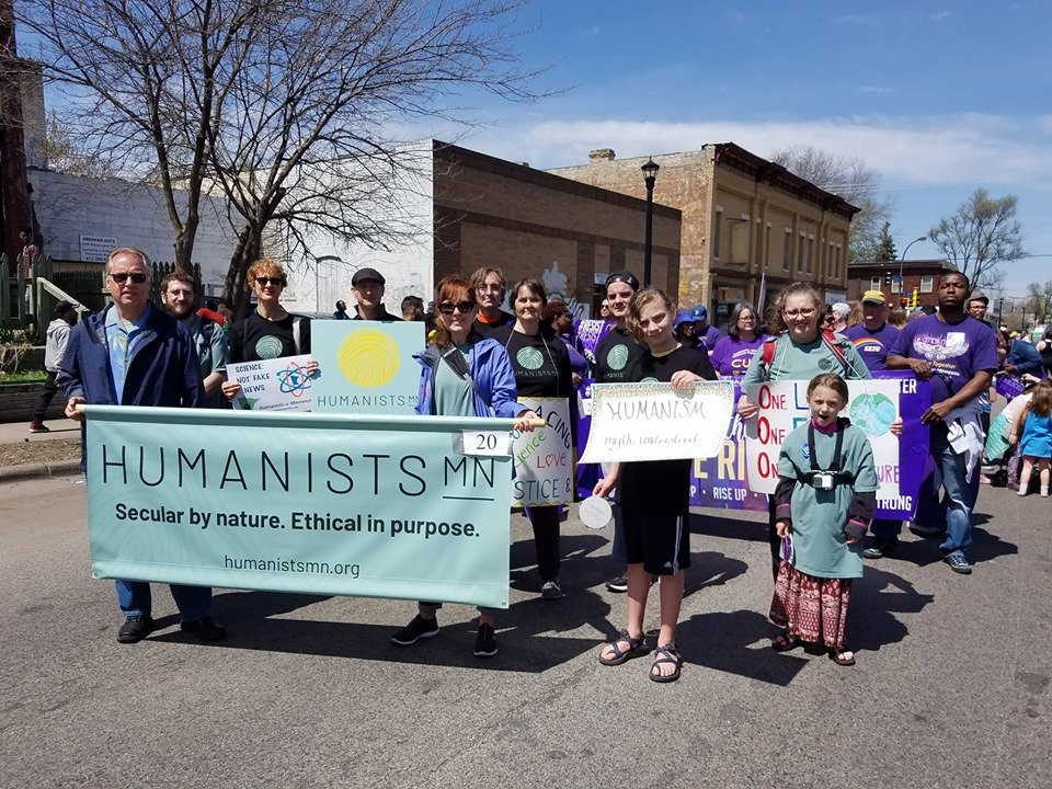 The new HumanistsMN banner, logo, and t-shirts appeared at the 2019 MayDay Parade.
